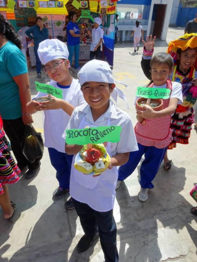 Peruvian kids holding food