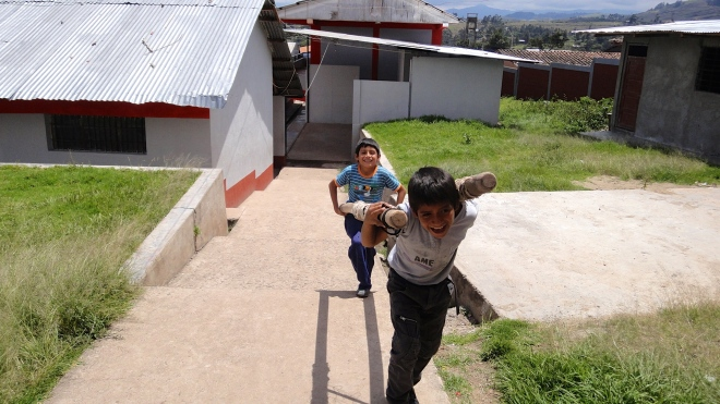 Peruvian students carry volleyball net