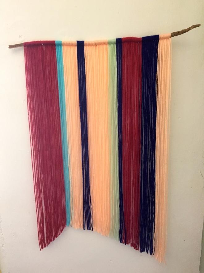 DIY yarn wall art Peace Corps cribs