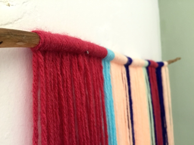DIY Yarn stick wall art Peace Corps cribs Peru